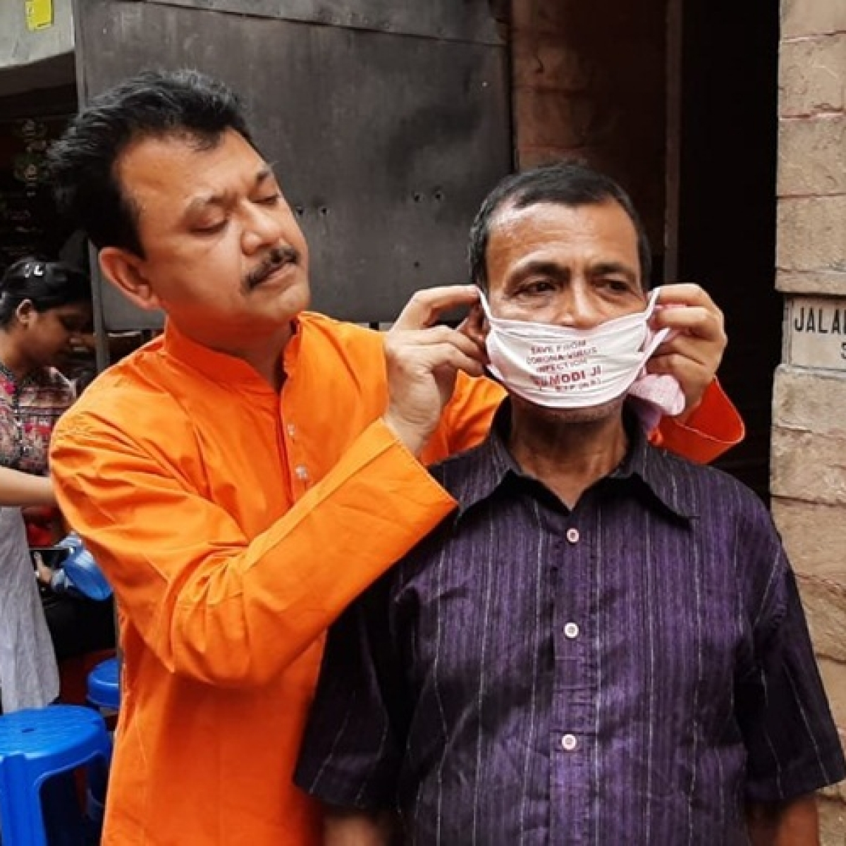 Commas matter: West Bengal BJP leader distributes masks with 'save us from coronavirus infection Modiji' message; gets trolled