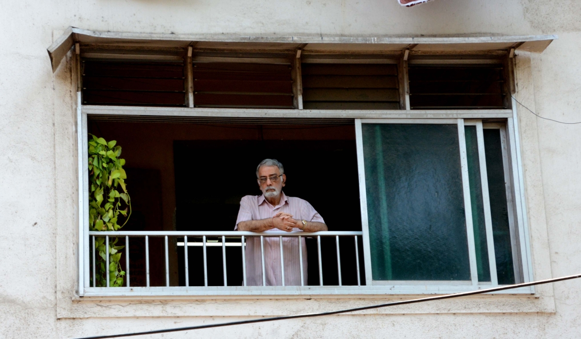 A man standing in his balcony at Grant Road during lockdown.