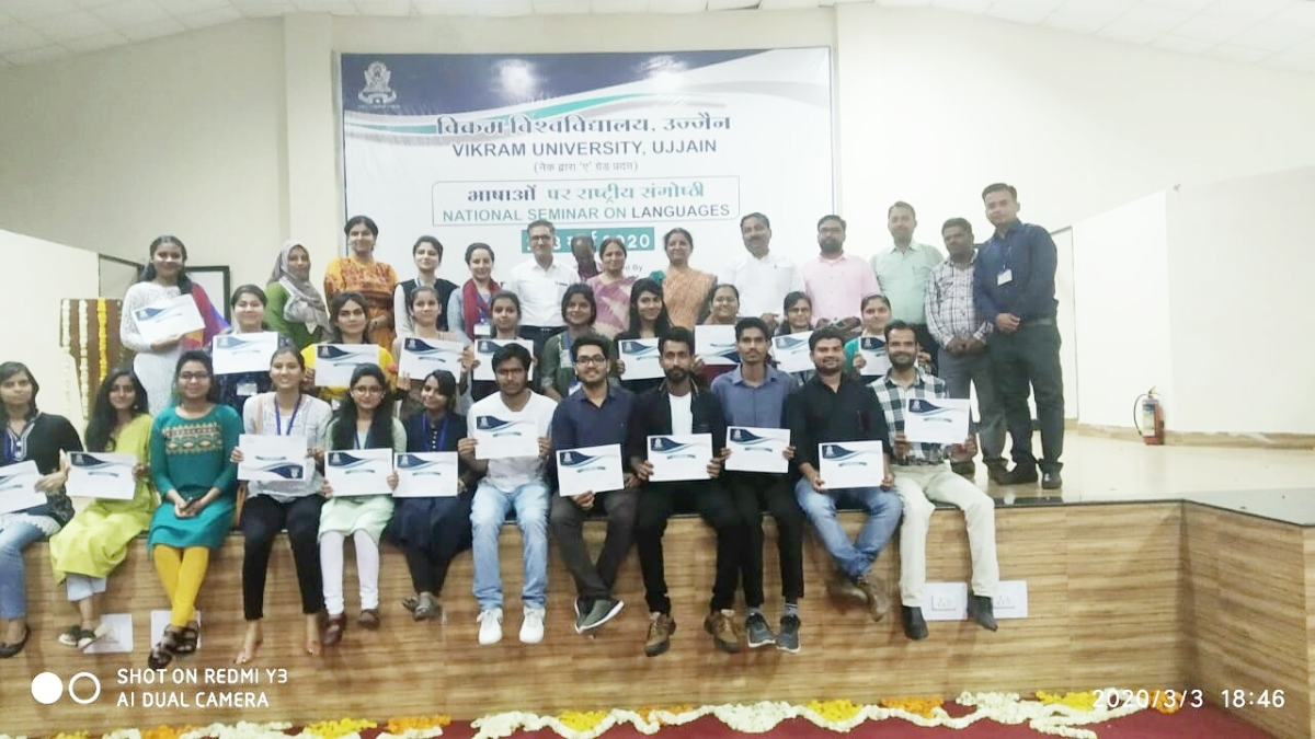 Participant students pose for group photograph during the valedictory session of a two-day national seminar on languages.