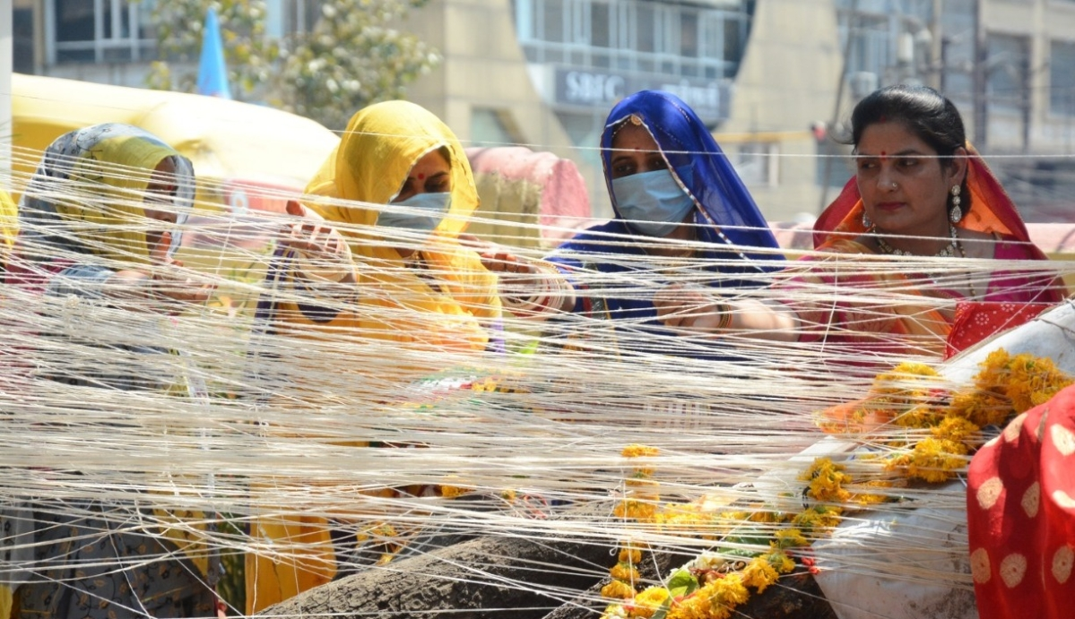 Women participated in celebrations and prayers while wearing protective masks