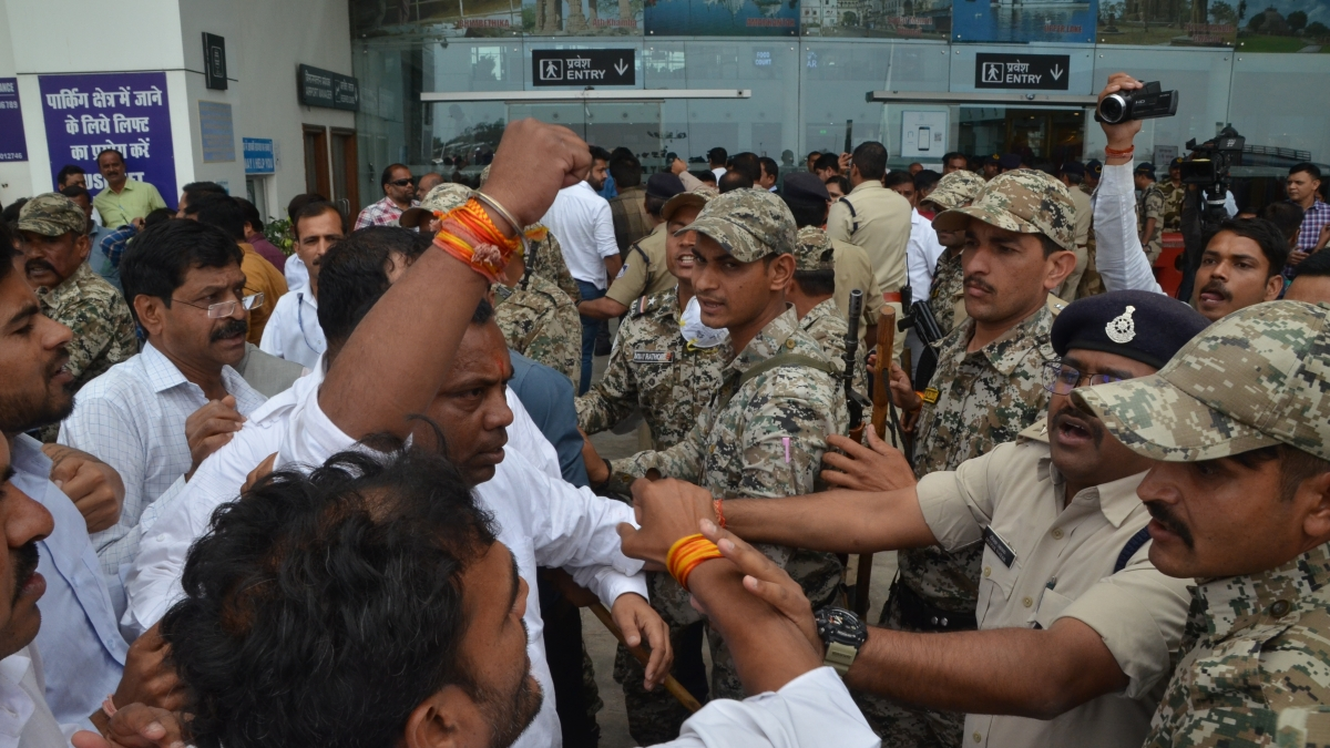 CRPF and state police separate Congress men and supporters of Jyotiraditya Scindia when become physical at Airport during protest on Friday.