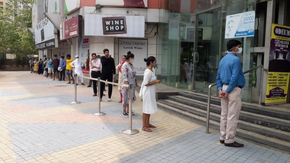 People standing in queue at Star bazar in Andheri West
