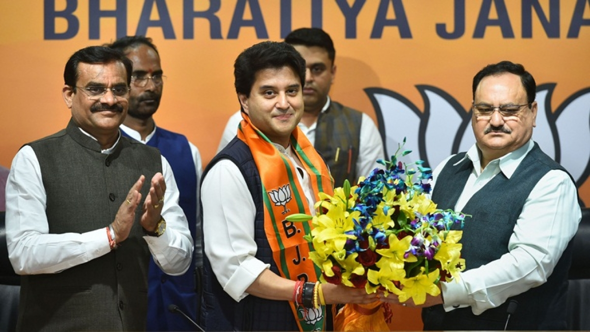 Former Congress leader Jyotiraditya Scindia is welcomed as he joins the Bharatiya Janata Party in the presence of party President JP Nadda at BJP headquarters in New Delhi