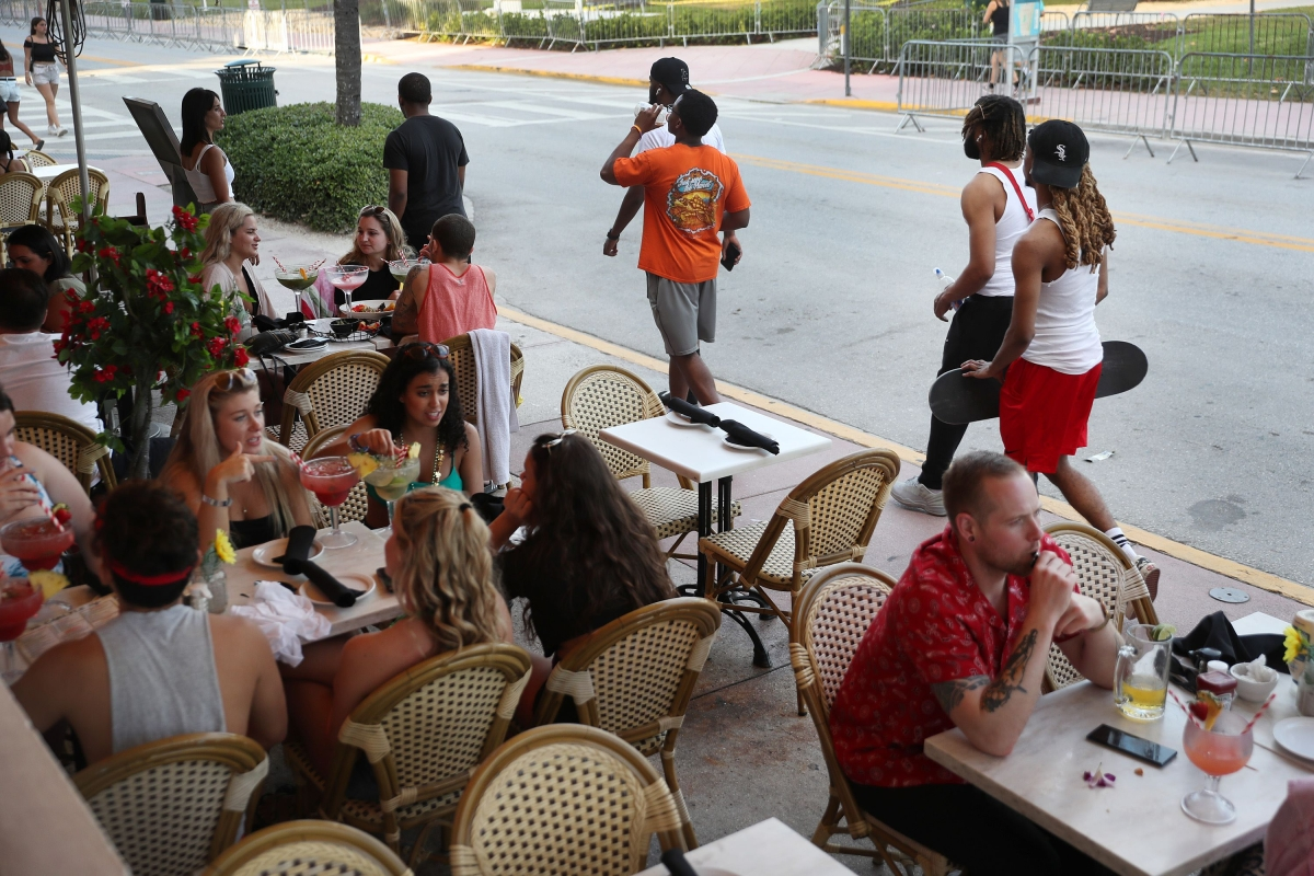 People eat at a restaurant along Ocean Drive in Miami Beach, Florida.