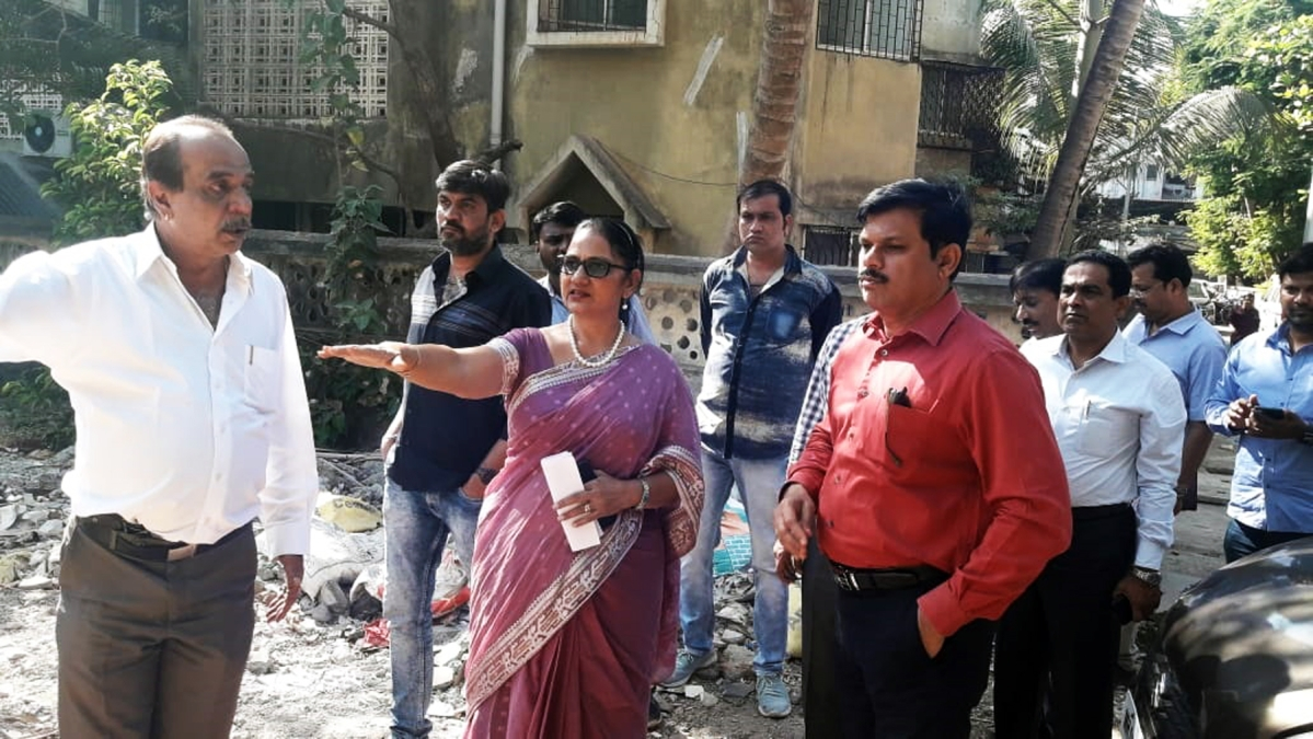 The civic chief inspecting one of the RG plots in Mira Road