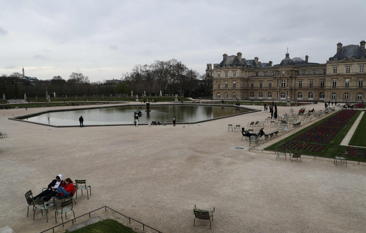 A picture shows a general view of the partly empty Luxembourg Gardens in Paris.