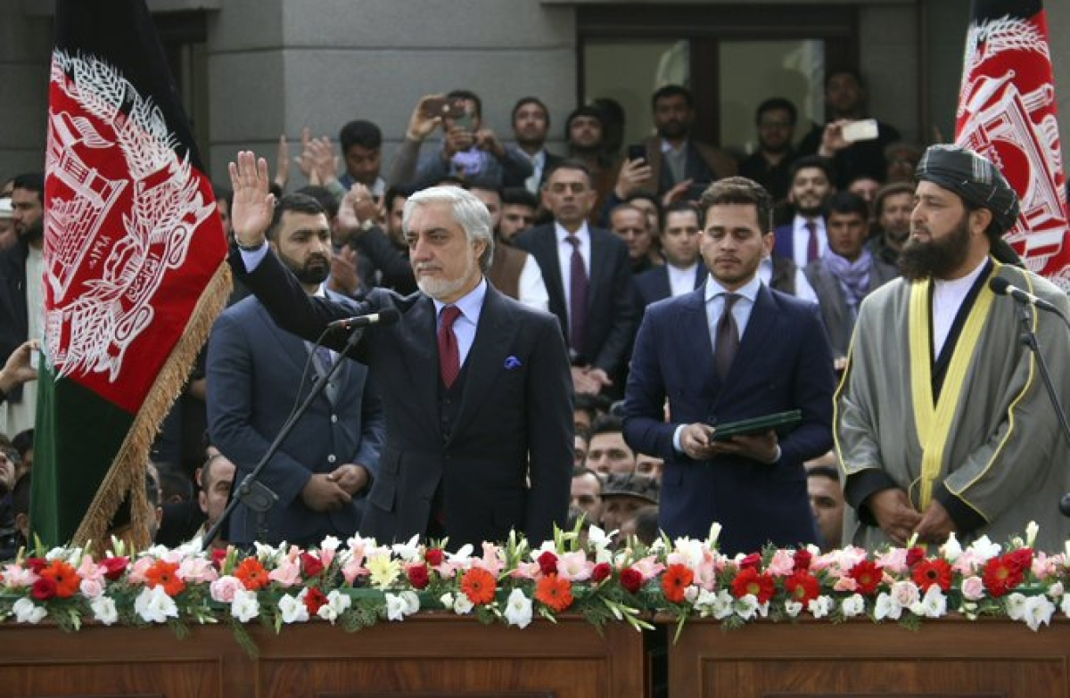 Afghanistan's Abdullah Abdullah, (front left) greets his supporters after being sworn in as president in Kabul.