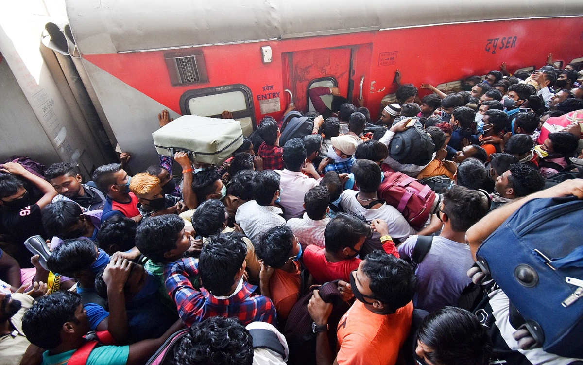 People throng to Mumbai's Lokmanya Tilak Terminal to catch trains leading to their village as they flee from the city to avoid coronavirus