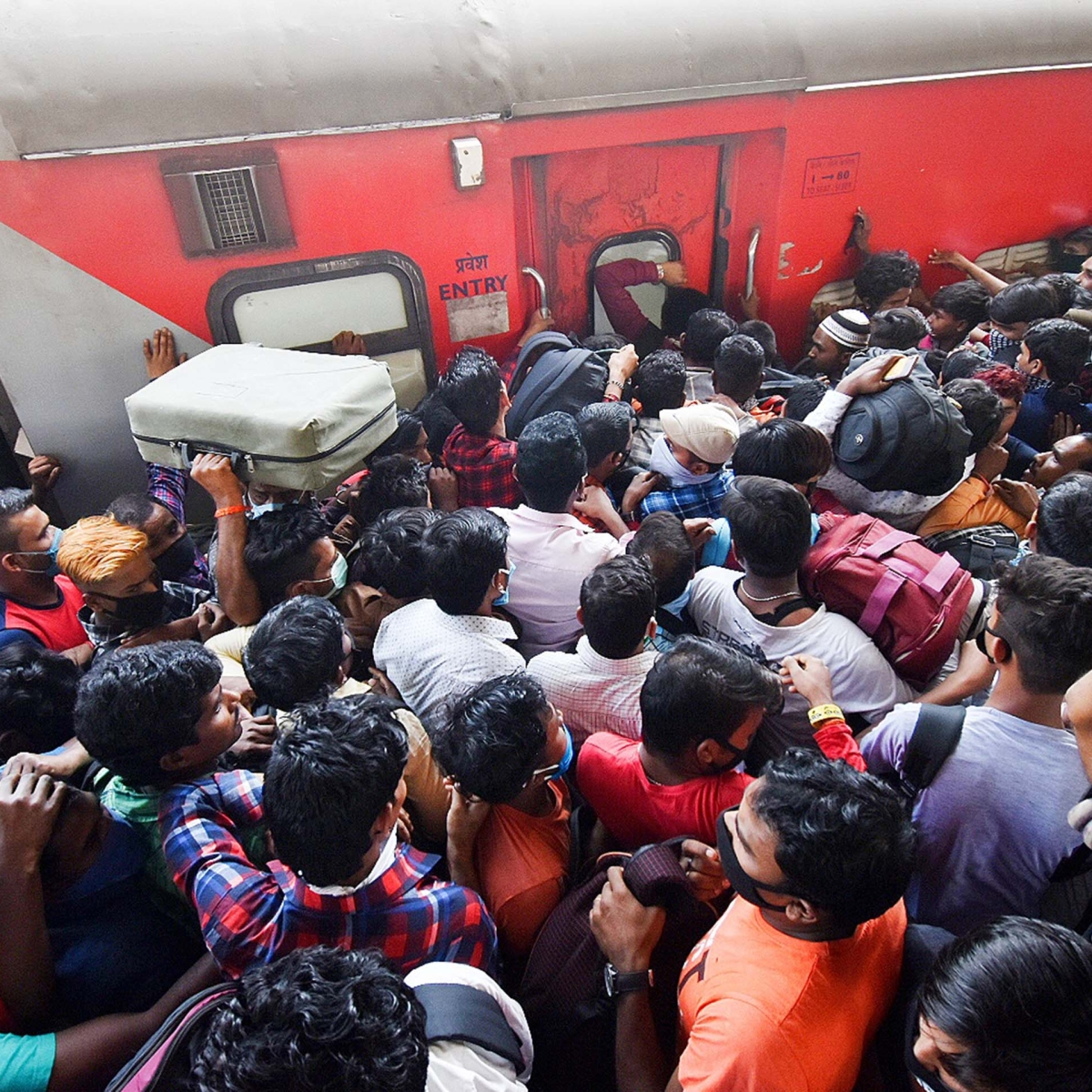 From staying off the streets to crowding trains leaving the city -- Mumbaikars reel under coronavirus restrictions