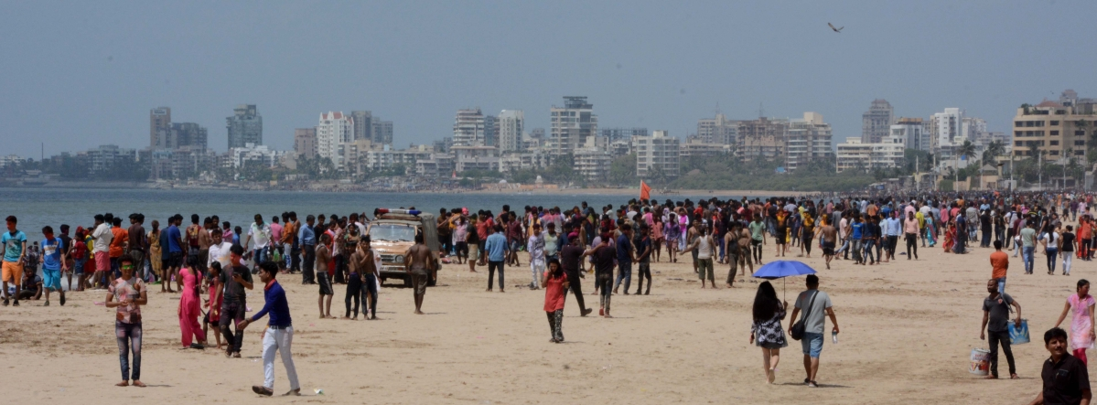 People celebrate Holi at Mumbai's Juhu Beach