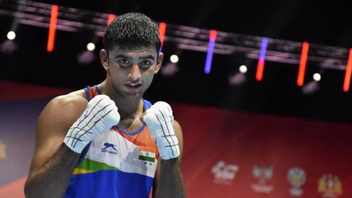 Injured Vikas Krishan pulls out of final, settles for silver, Manish Kaushik qualifies for Olympics