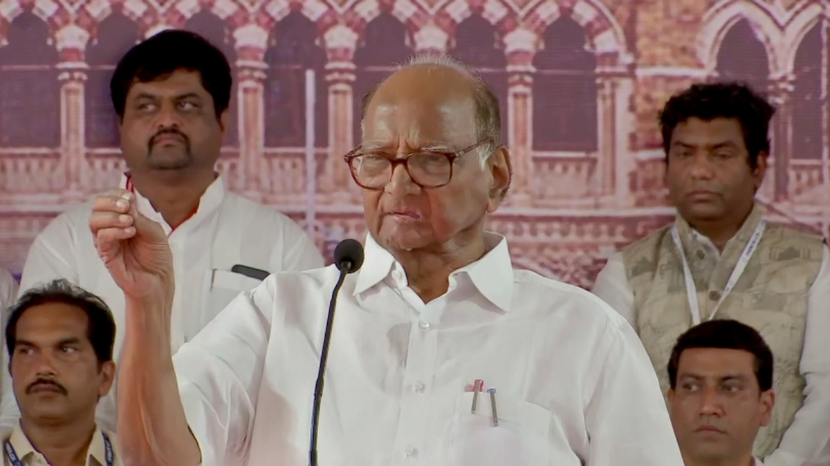 NCP chief Sharad Pawar speaks during party workers meet, in Mumbai on Sunday.
