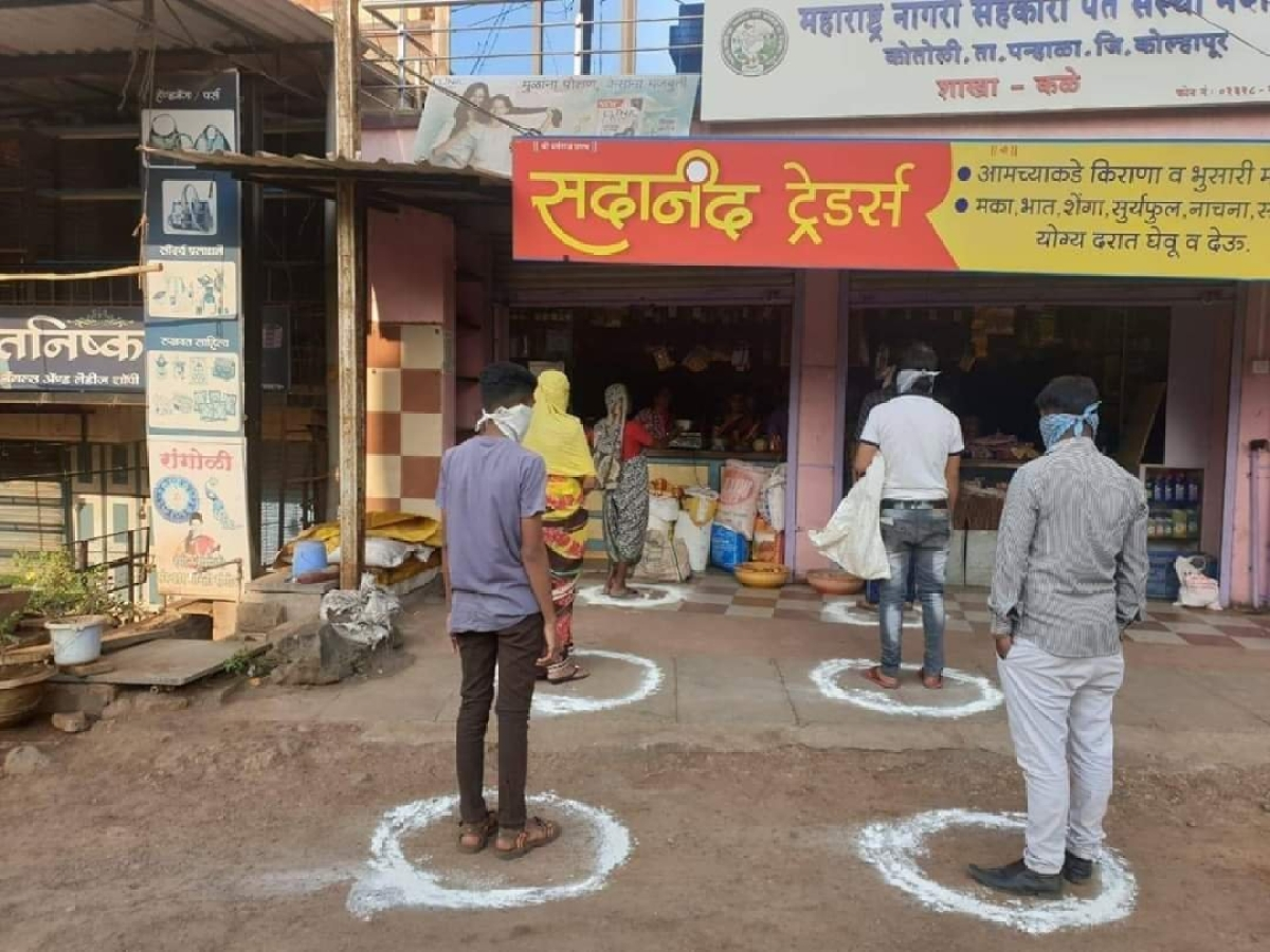 Consumers standing in marked circles to mainstain distance amid coronavirus pandemic while buying daily essential commodities.