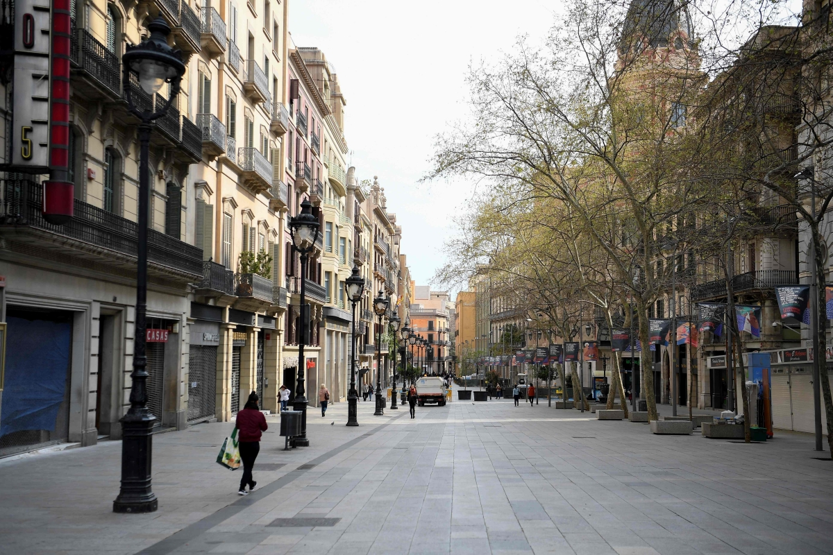 A commercial street remains empty in Barcelona after regional authorities ordered all shops in the region be shuttered in order to slow the coronavirus spread.