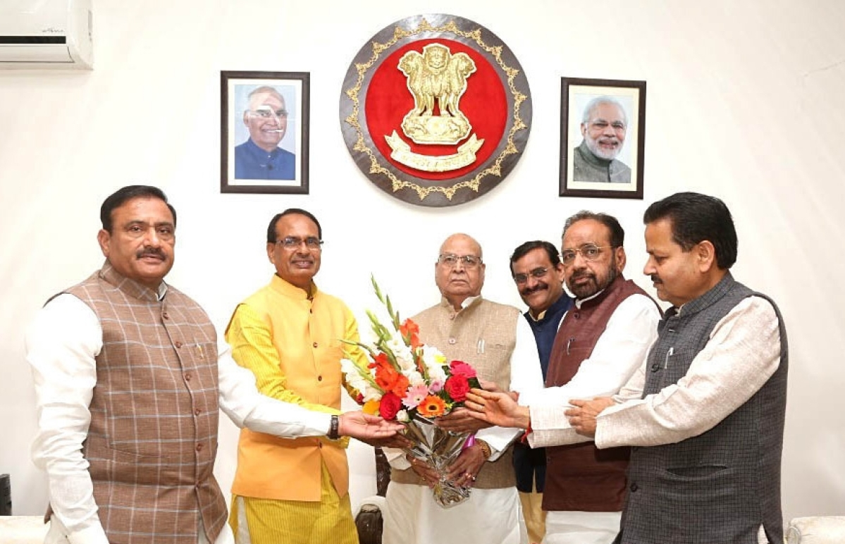 BJP National Vice President Shivraj Singh Chouhan with BJP State President VD Sharma, leader of the opposition in the State Assembly Gopal Bhargava and other party MLAs meets Governor Lalji Tandon demanding to stop the appointments on constitutional posts by  Kamal Nath led Congress State  Government, at Raj Bhavan in Bhopal on Tuesday.
