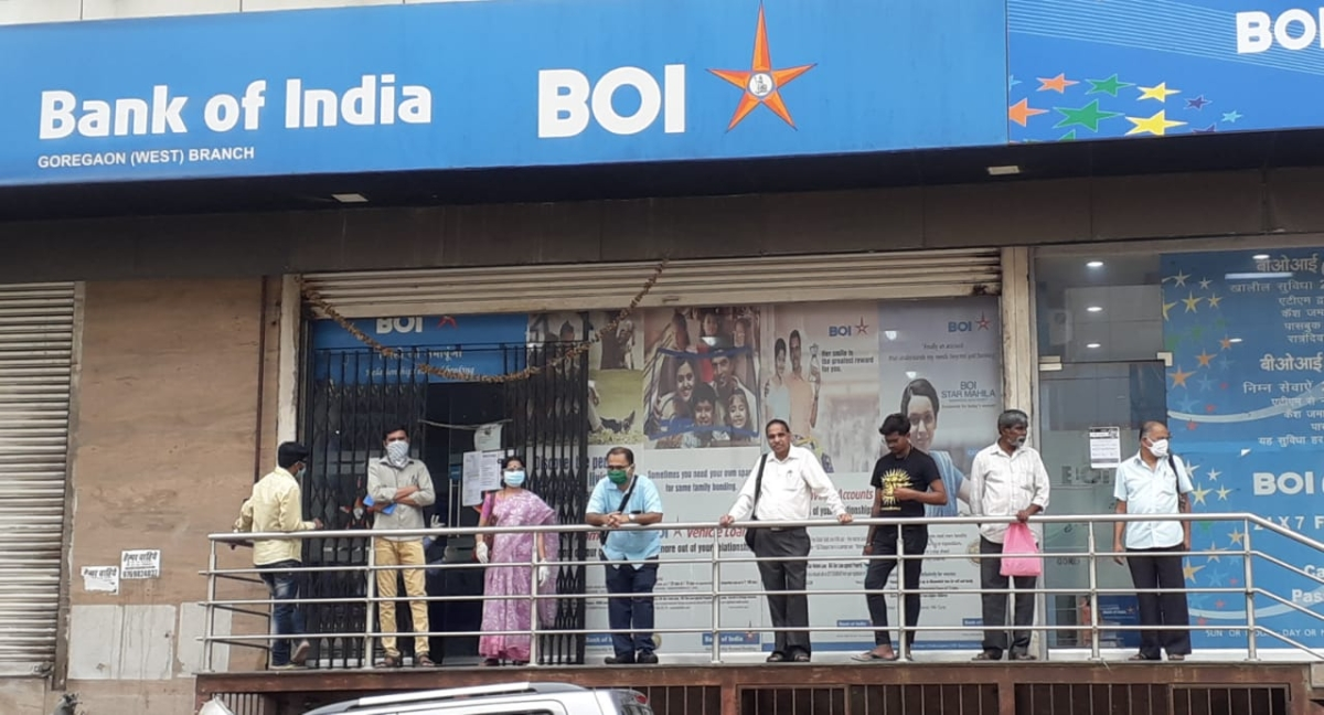 People standing in an ATM queue in Goregaon West