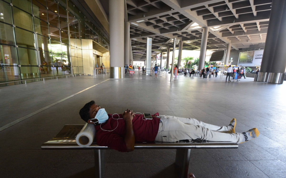 A cargo worker relaxes at the Mumbai International Airport