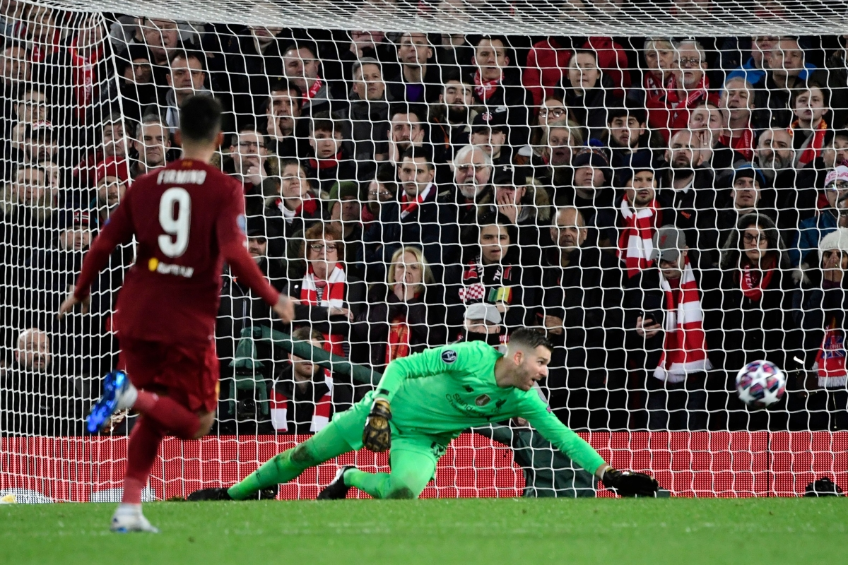 Liverpool's Spanish goalkeeper Adrian tracts as Atletico Madrid's Spanish midfielder Marcos Llorente scores his team's first goal.
