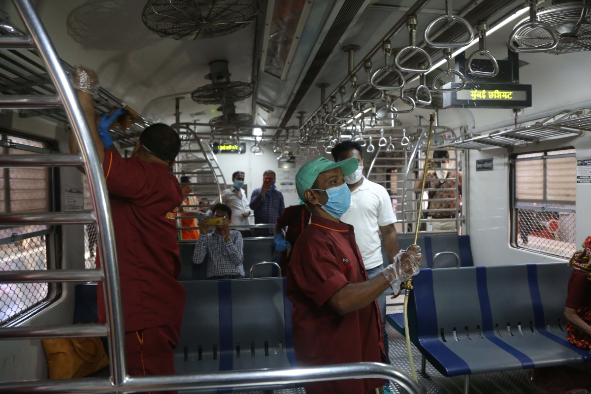 Railway workers carry out disinfection process in local trains