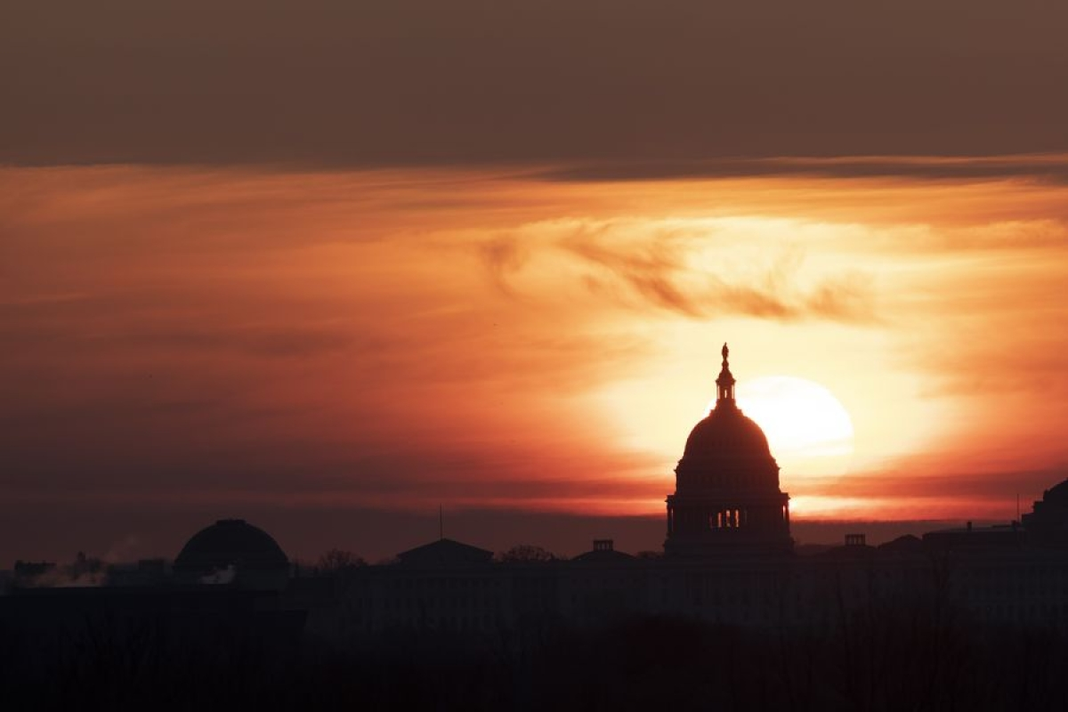 The U.S. Capitol Building is silhouetted against sunrise in Washington D.C., the United States, on March 18, 2020.