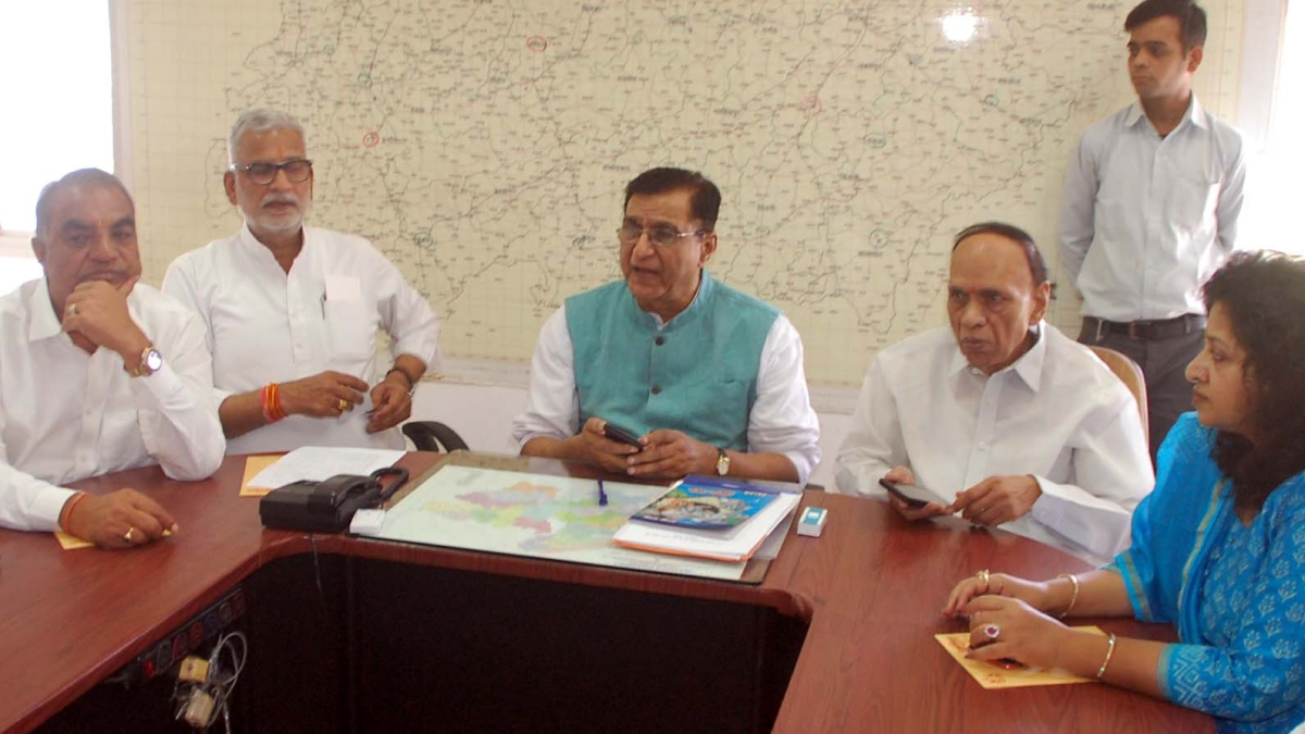 AICC general secretary and state in charge Deepak Babaria in a meeting with congress members.