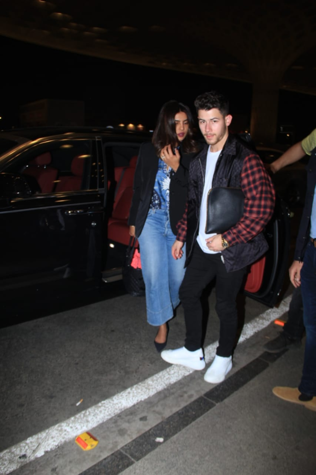 Priyanka Chopra and Nick Jonas at the airport