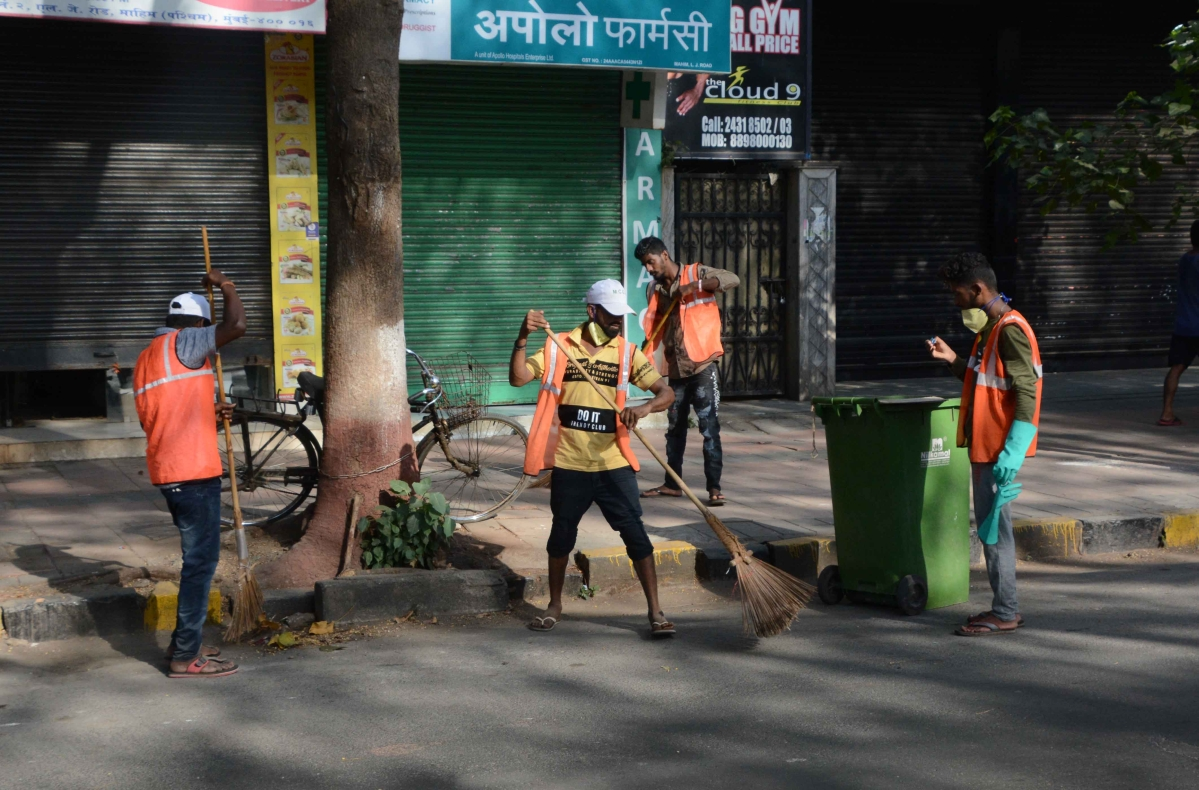 BMC Workers busy cleaning work in dadar during lock down in the wake of Coronavirus pandemic in Mumbai on Monday.