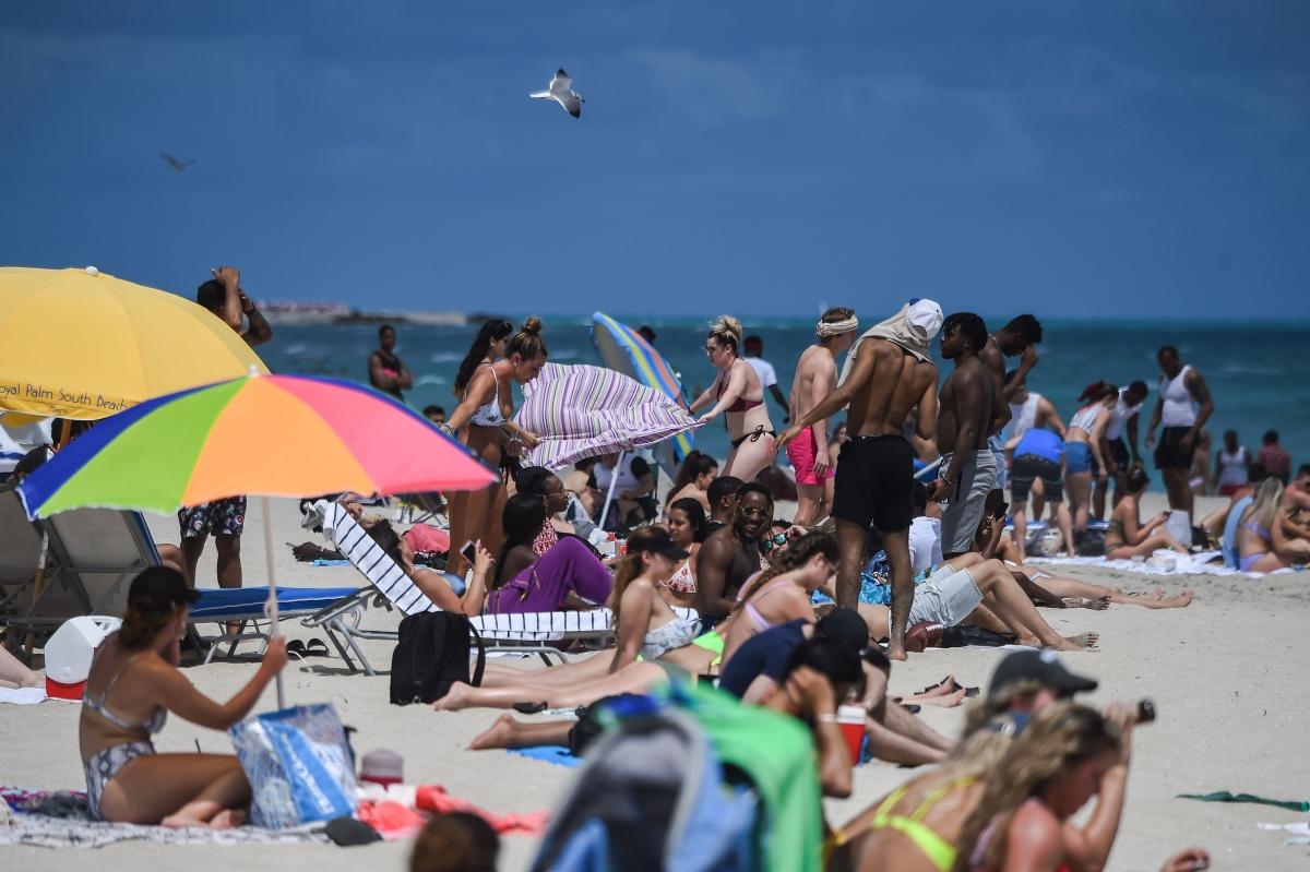 Tourists enjoy the water in Miami Beach, Florida