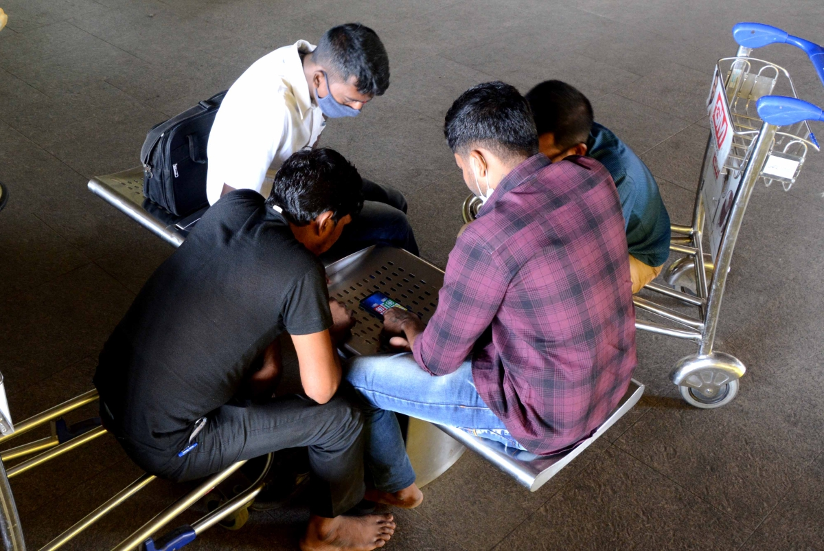 Cargo workers play Ludo