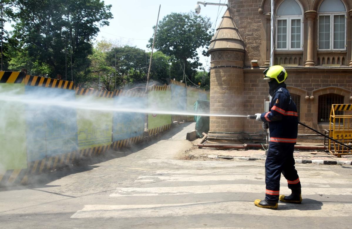 Firebrigade workers splashing water outside BMC office