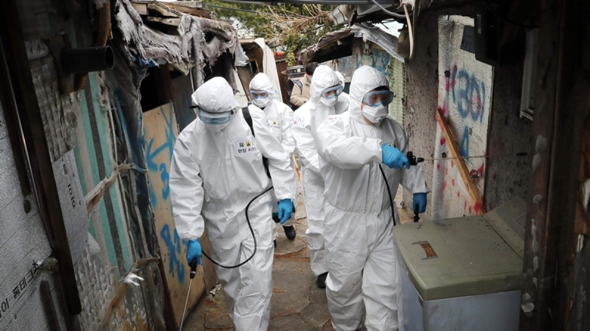 People examining a containment area