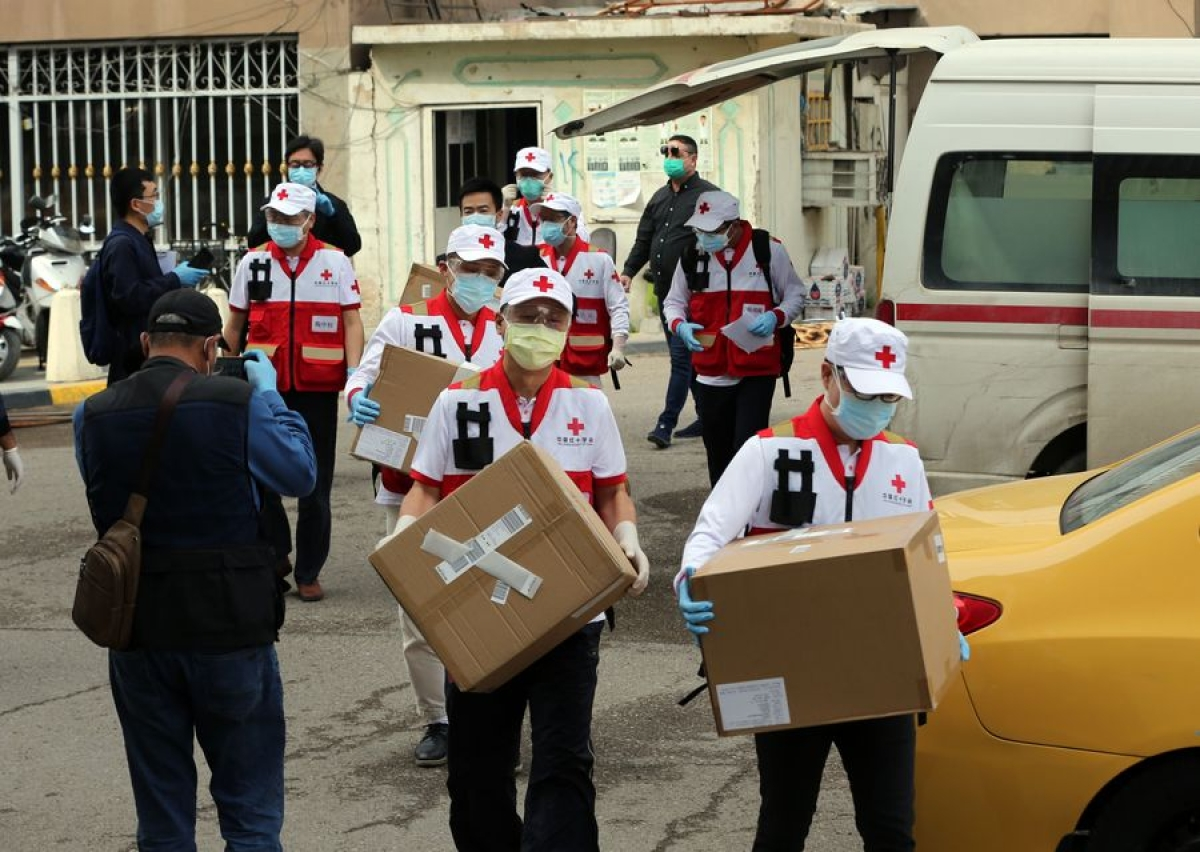 A Chinese team of health experts sent to provide assistance to contain the COVID-19 outbreak in Iraq work in Baghdad, Iraq, March 25, 2020.