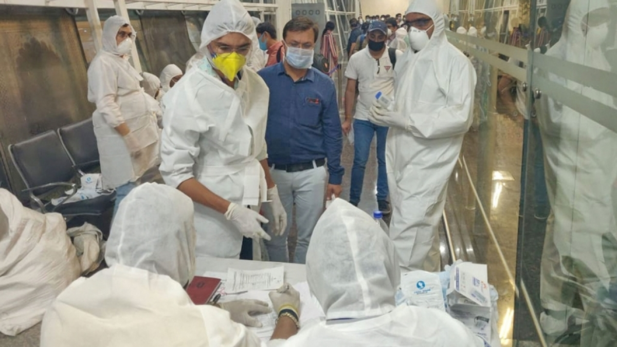 Health officials screen passengers arriving from Dubai before being sent to hospital in the wake of coronavirus pandemic, in Indore