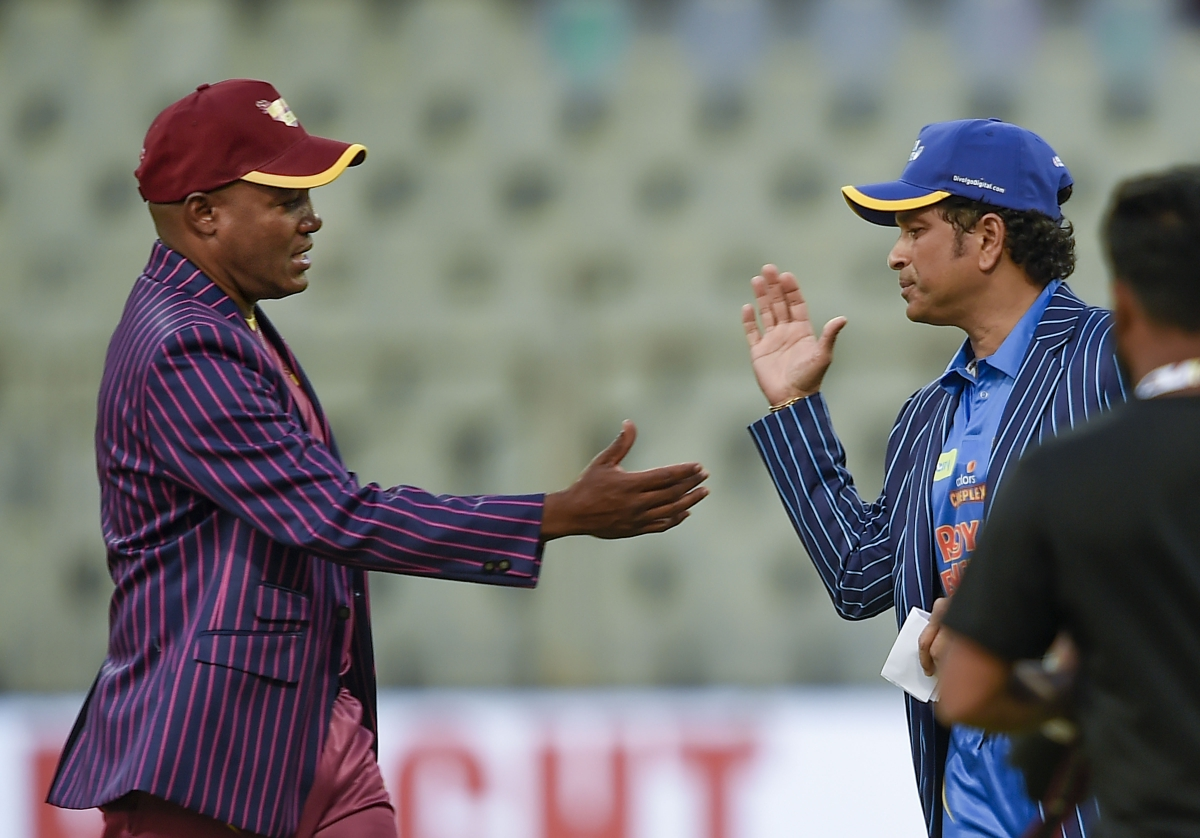 West Indies Legends Captain Brian Lara along with India Legends Captain Sachin Tendulkar during toss of Road Safety World Series Cricket T20 match between the two teams at Wankhede Stadium in Mumbai.