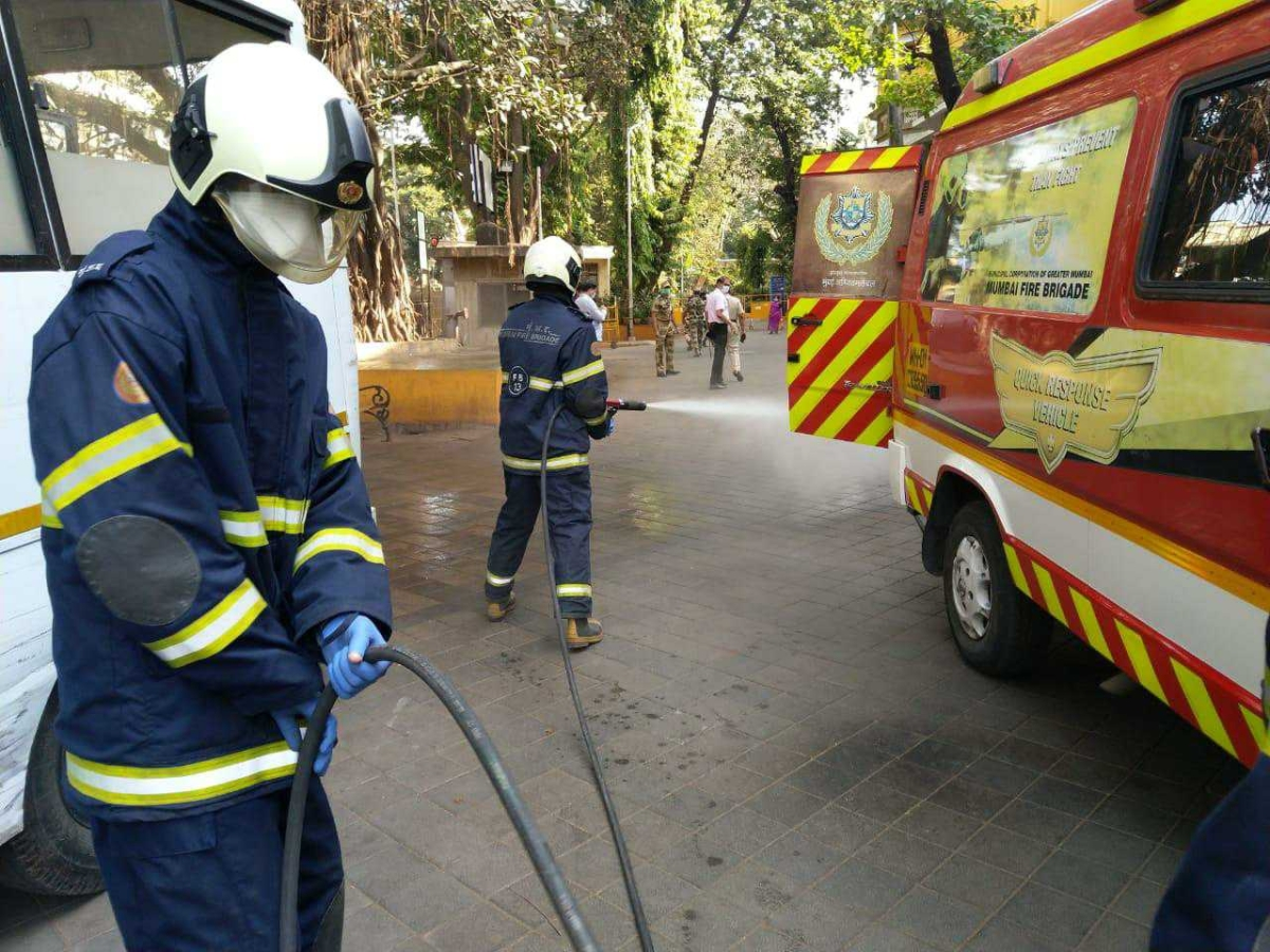 Mumbai Fire Brigade staffer disinfect the area near the hospital premises