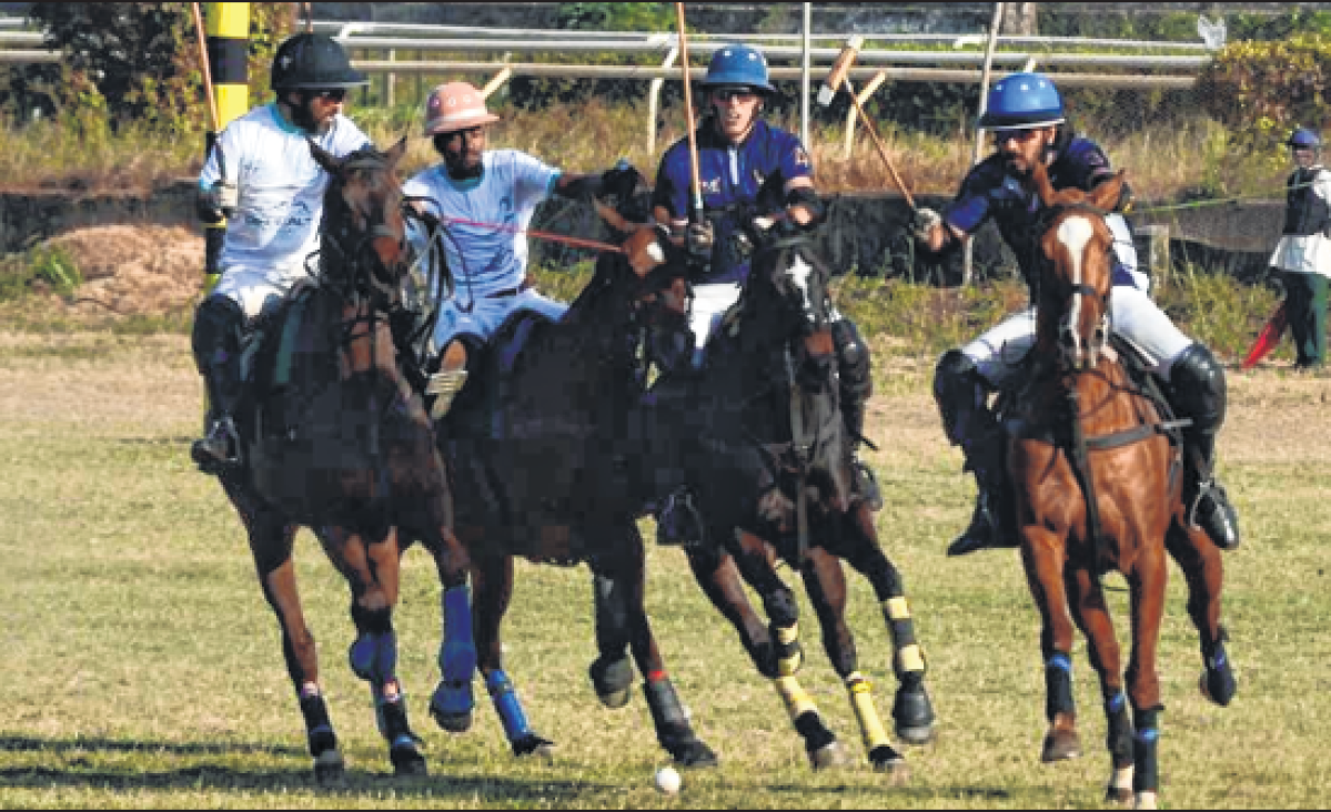 Los Polistas (Blue) and DB Reality Achievers (white) in action during the final of the Maharaj Prem Singh Tournament 8 Goal which was held at the polo ground, Mahlaxmi racecourse on Saturday. DB Reality Achievers pipped Los Polistas 6-5.