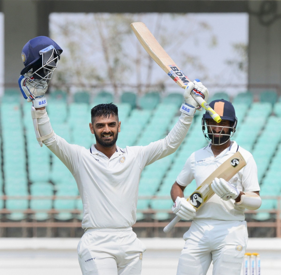 Saurashtra batsman Arpit Vasavada celebrates after scoring 100 runs during the Ranji final match against Bengal in Rajkot on Tuesday.