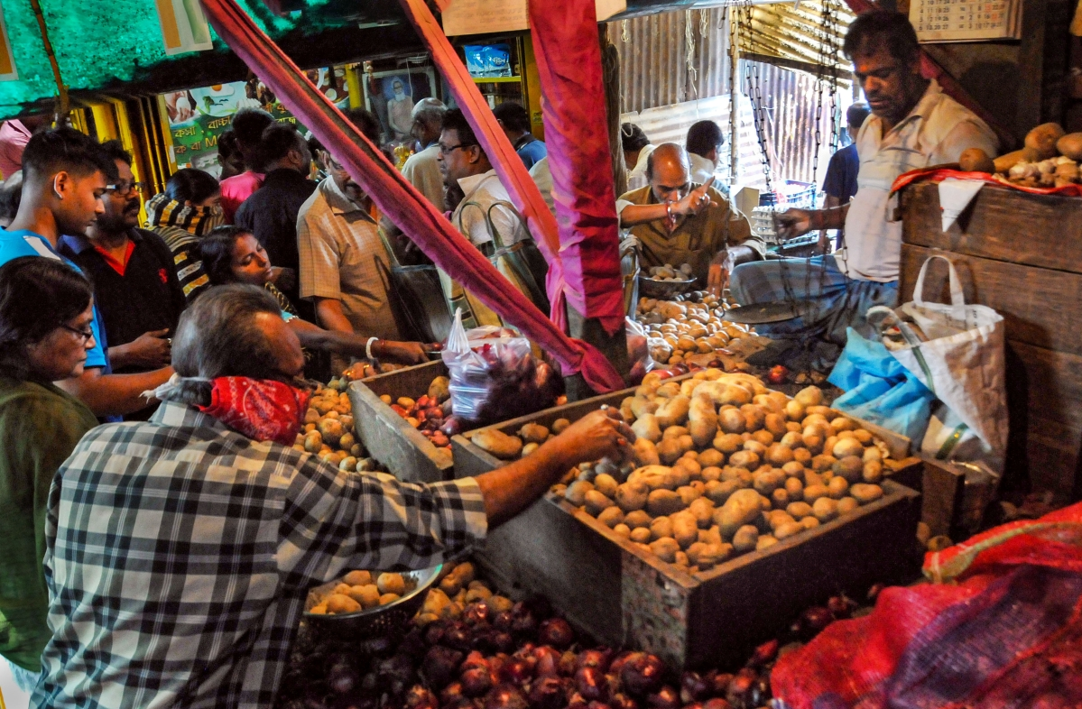 Locals buy vegetables before lockdown amid rising concerns over the coronavirus pandemic, in Kolkata, Monday, March 23, 2020.