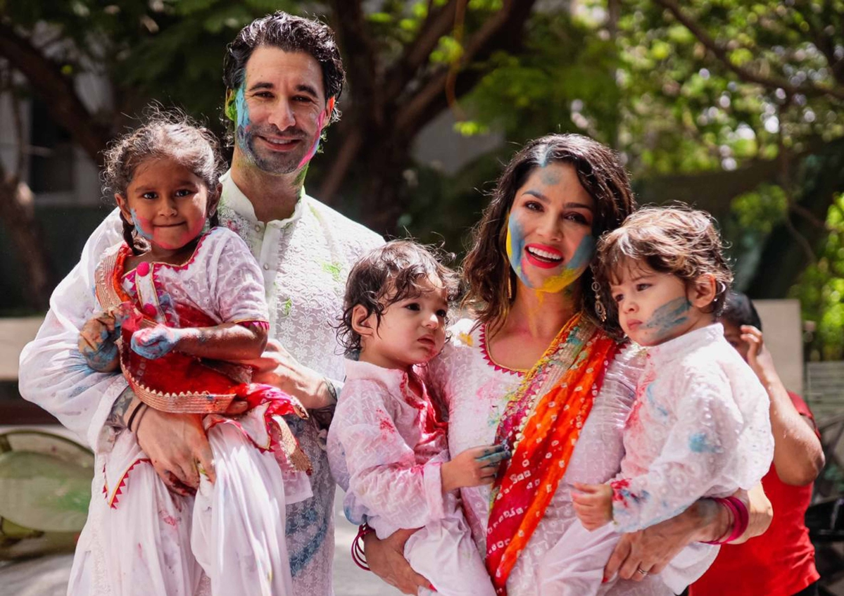 Actor Sunny Leone plays holi with her family in Mumbai's Juhu.