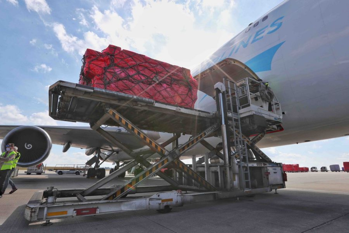 Medical materials from China arrive at the Liege airport in Belgium, on March 18, 2020. A batch of 1 million donated medical masks were flown in Belgium on March 18, en route to France. The medical supply was mobilized by two Chinese charities to help combat the spread of COVID-19.