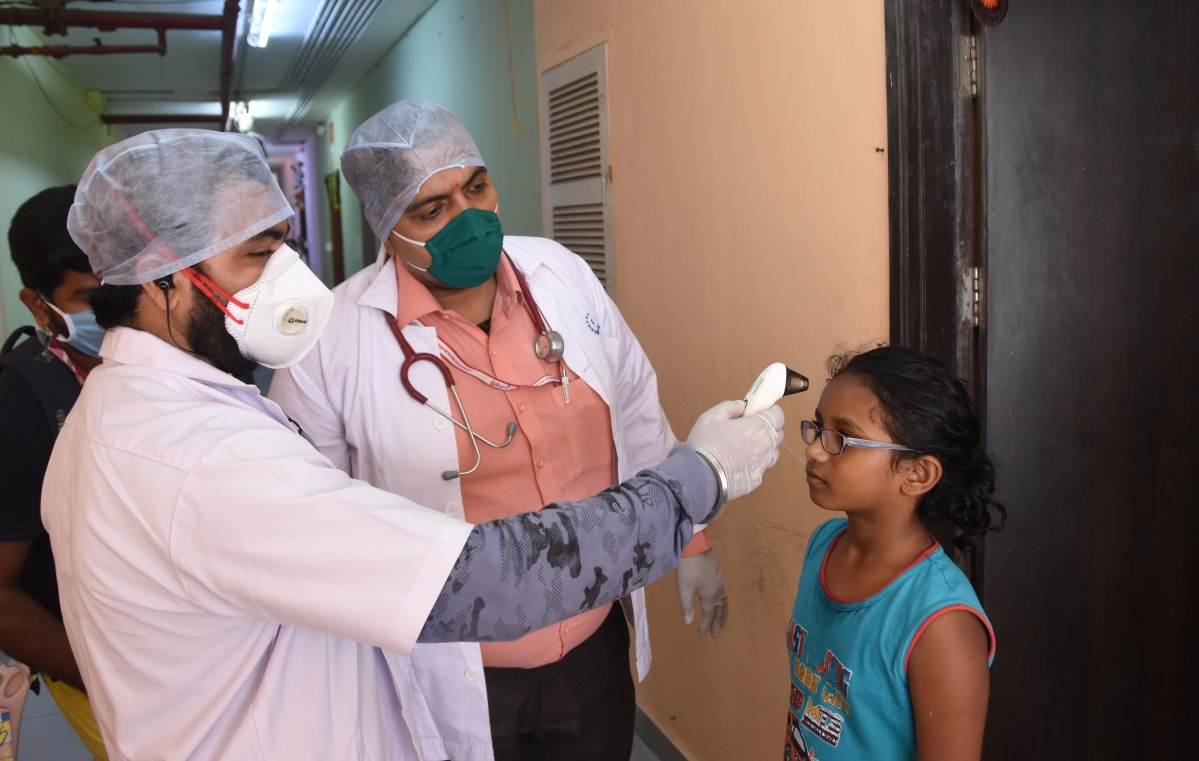 One rupee clinic checking door to door citizenís health by Thermal Screening status at mahalaxmi society in Lower Parel.