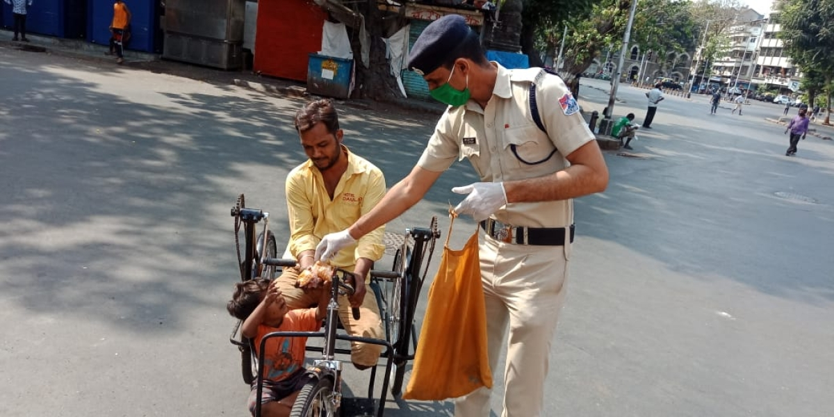 Police distributing food to the needy ones.
