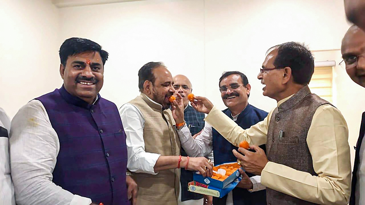 BJP National Vice President Shivraj Singh Chouhan and leader of the opposition in the State Assembly Gopal Bhargava with party MLAs celebrate after Chief Minister Kamal Nath resigned from his post, at BJP State headquarters in Bhopal.