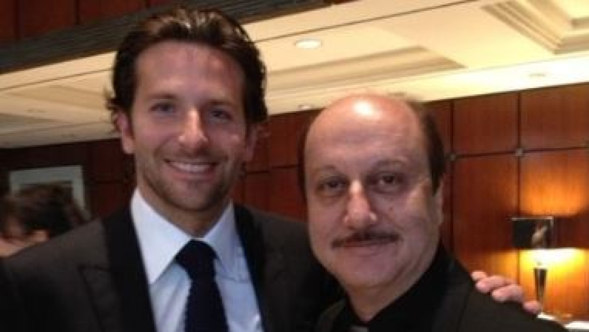 Hollywood actor Bradley Cooper and Bollywood actor Anupam Kher (R).
