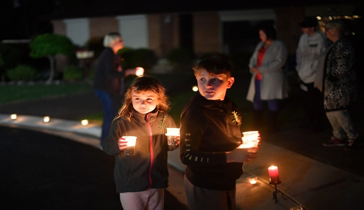 Residents light candles to decorate driveways for the Anzac Day dawn service in the Ingleburn suburb of Sydney.