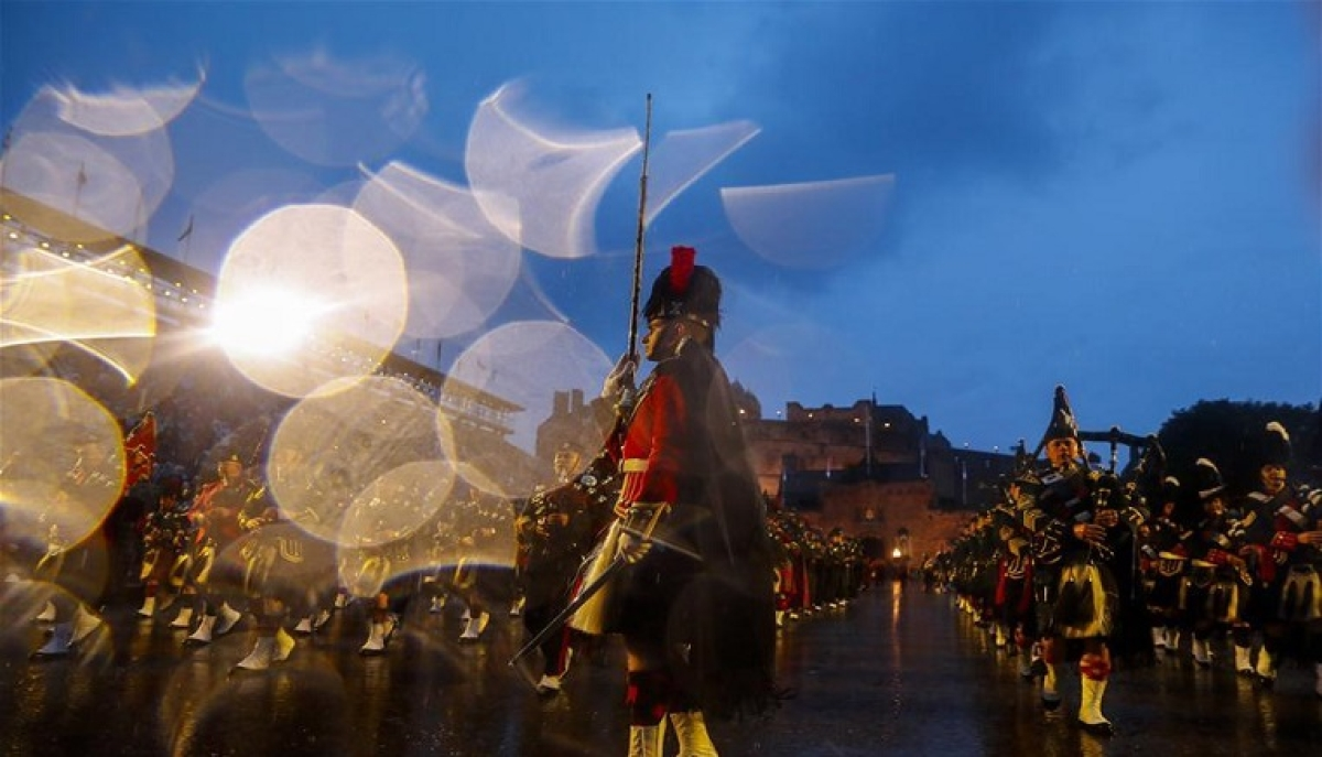 File Photo taken on Aug. 6, 2019 shows military performers in front of the Edinburgh Castle during the Royal Edinburgh Military Tattoo 2019 in Edinburgh, Britain. For the first time in over 70 years, a series of festivals that transform Edinburgh into the world's leading cultural destination every August are not going ahead as planned due to concerns over the COVID-19 pandemic, the organizers said on April 1, 2020.
