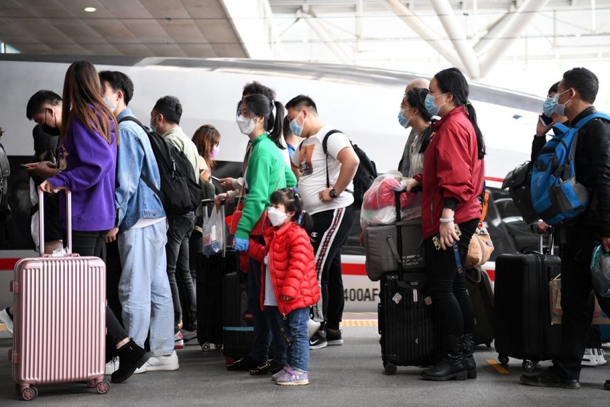 Passengers get off the high-speed train G1005 from Wuhan at Shenzhen North Railway Station in Shenzhen, south China's Guangdong Province, April 8, 2020.