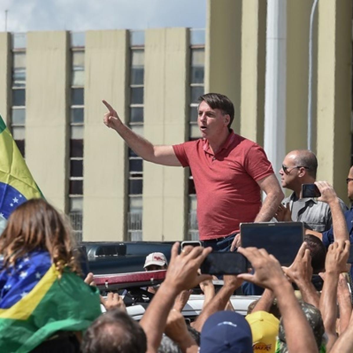 Brazil's President Jair Bolsonaro appears in protest backing military