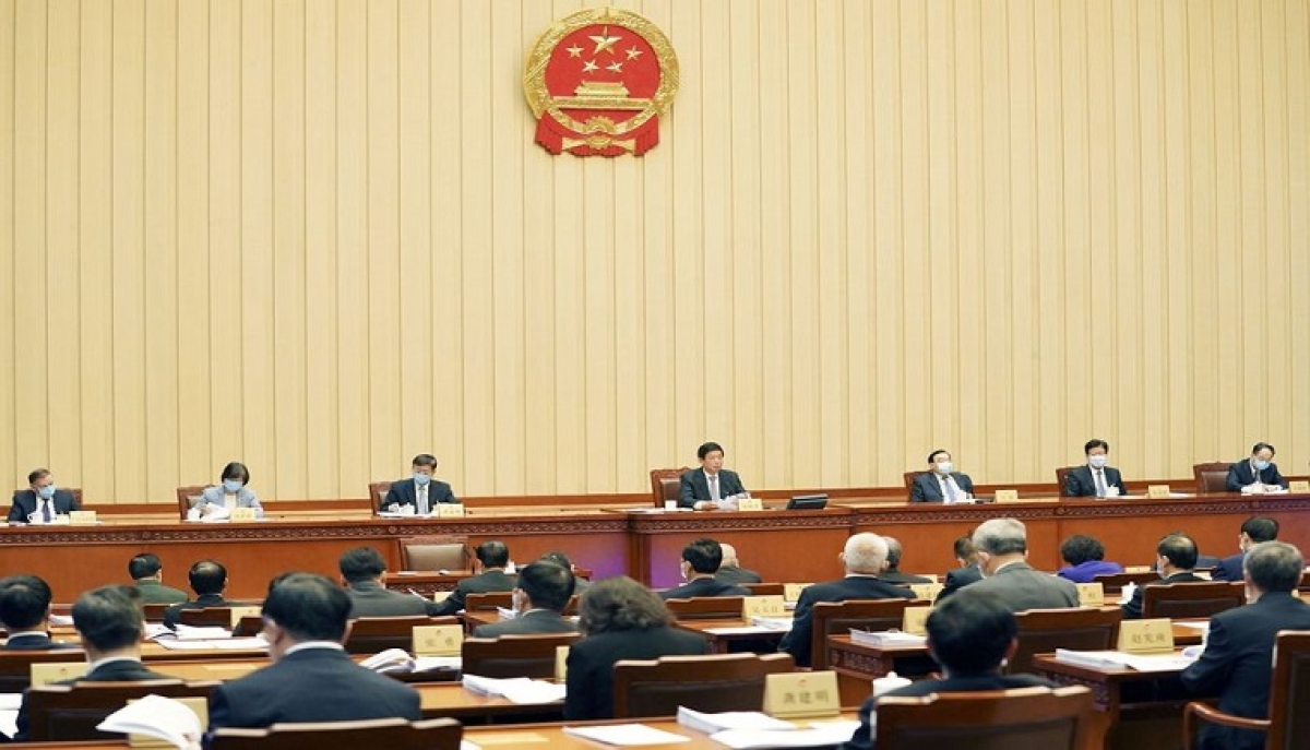 Li Zhanshu, chairman of the National People's Congress (NPC) Standing Committee, presides over the closing meeting of the 17th session of the 13th NPC Standing Committee in Beijing, capital of China, April 29, 2020.