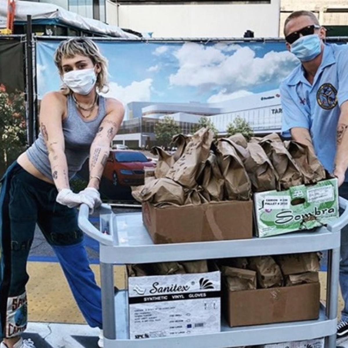 Miley Cyrus, Cody Simpson deliver tacos to healthcare workers amid coronavirus lockdown